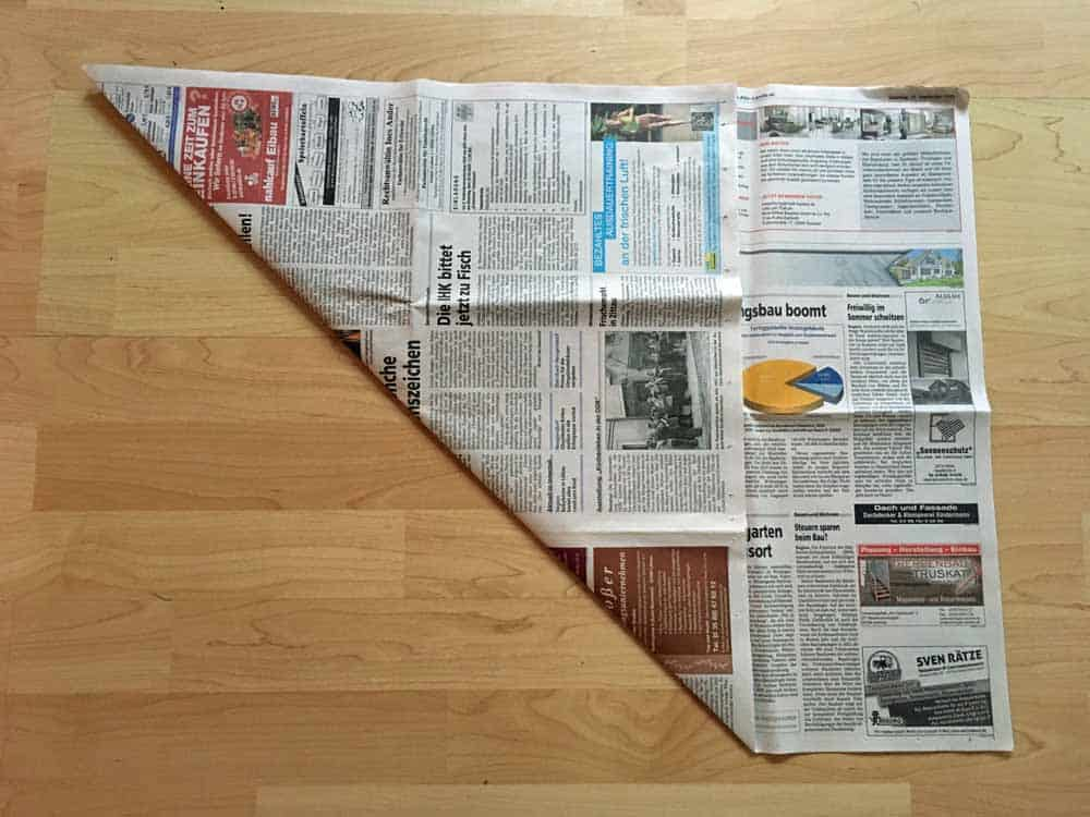 Fold newspaper to triangle